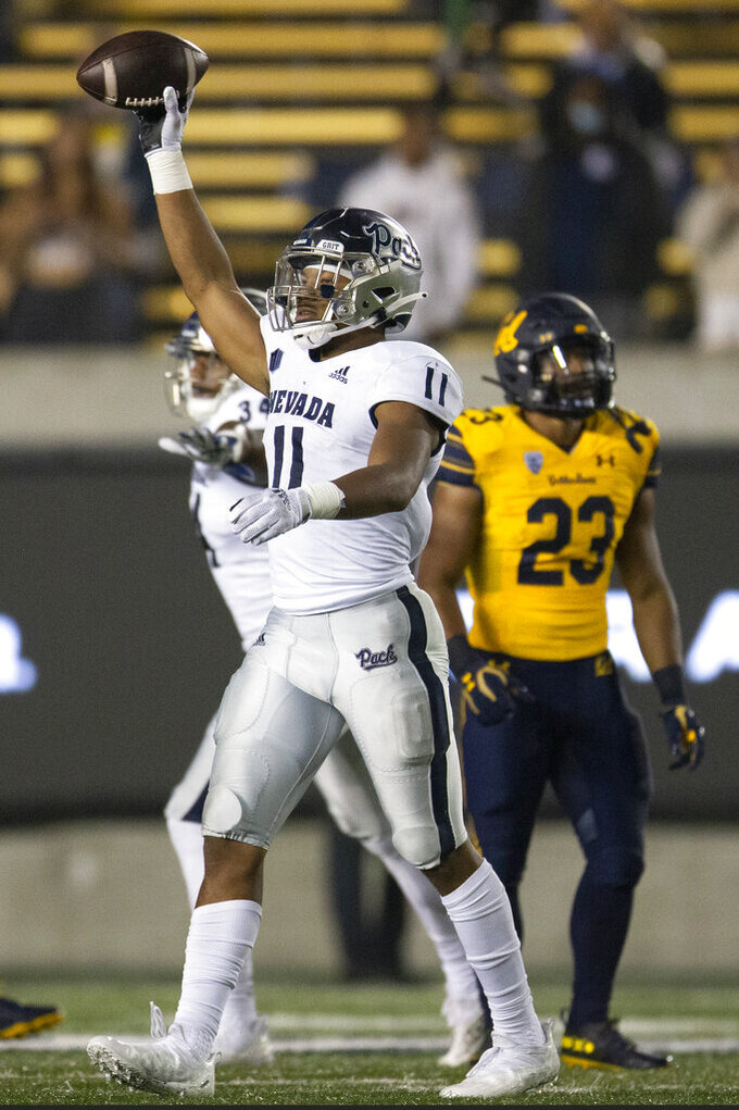 Nevada linebacker Daiyan Henley (11) celebrates securing his team's 22-17 victory over California during the fourth quarter of an NCAA college football game, Saturday, Sept. 4, 2021, in Berkeley, Calif. (AP Photo/D. Ross Cameron)