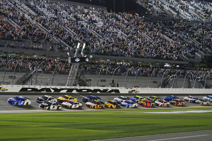 Ricky Stenhouse Jr. (47) and Chase Elliott (9) lead the field to start the first of two NASCAR Daytona 500 qualifying auto races at Daytona International Speedway, Thursday, Feb. 13, 2020, in Daytona Beach, Fla. (AP Photo/Terry Renna)