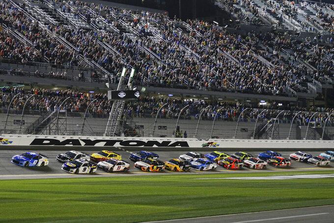 Ricky Stenhouse Jr. (47) and Chase Elliott (9) lead the field to start the first of two NASCAR Daytona 500 qualifying auto races at Daytona International Speedway, Thursday, Feb. 13, 2020, in Daytona Beach, Fla. (AP Photo/Terry Renna)