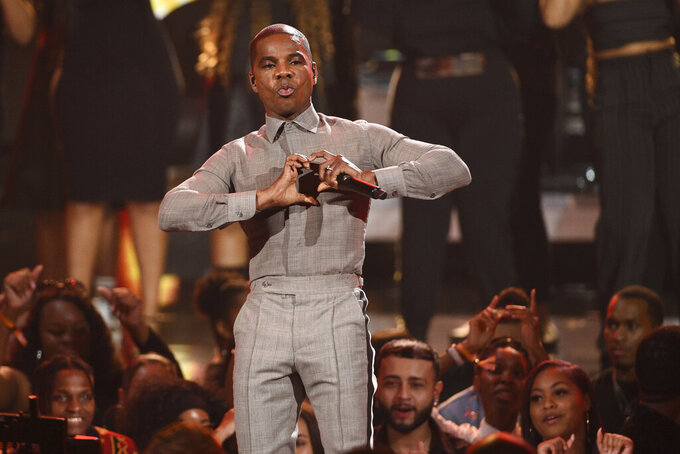 FILE - In this June 23, 2019, file photo, Kirk Franklin gestures as he performs at the BET Awards in Los Angeles. Franklin made a splash at the Stellar Gospel Music Awards. The singer took home six trophies during the 35th annual awards on Sunday night, Aug. 23, 2020. (Photo by Chris Pizzello/Invision/AP, File)