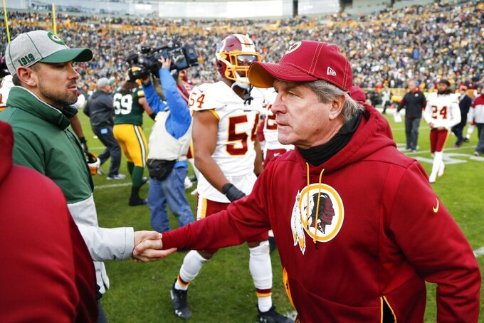 Washington Redskins head coach Bill Callahan shakes hands with Green Bay Packers head coach Matt LaFleur after an NFL football game Sunday, Dec. 8, 2019, in Green Bay, Wis. The Packers won 20-15. (AP Photo/Matt Ludtke)