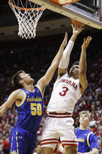 Indiana's Justin Smith (3) shoots over South Dakota State's David Wingett (50) during the first half of an NCAA college basketball game, Saturday, Nov. 30, 2019, in Bloomington, Ind. (AP Photo/Darron Cummings)