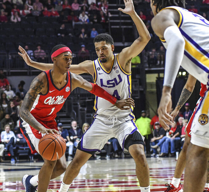 Mississippi guard Austin Crowley (1) dribbles against LSU guard Skylar Mays (4) during an NCAA college basketball game in Oxford, Miss., Saturday, Jan. 18, 2020. (Bruce Newman/The Oxford Eagle via AP)