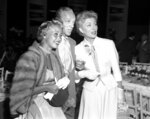 """FILE - In this Sept. 9, 1953 file photo, Jane Powell, left, Fred Astaire, center and Greer Garson pose for a photo in Los Angeles. Jane Powell, the bright-eyed, operatic-voiced star of Hollywood's golden age musicals who sang with Howard Keel in """"Seven Brides for Seven Brothers"""" and danced with Fred Astaire in """"Royal Wedding,"""" has died. Thursday, Sept. 16, 2021. She was 92. (AP Photo/Ellis Bosworth, File)"""