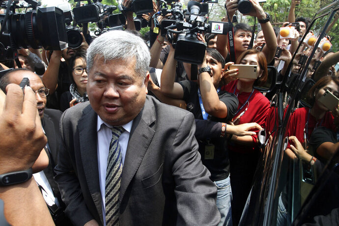 Thai billionaire construction tycoon Premchai Karnasuta leaves The Thong Pha Phum Provincial Court in Kanchanaburi, Thailand Tuesday, March 19, 2019. The court sentenced Premchai to 16 months in prison Tuesday for possessing the carcass of an endangered Kajij pheasant and possessing firearms in public areas. (AP Photo)