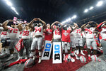 Ohio State players celebrate the team's 34-21 win over Wisconsin in the Big Ten championship NCAA college football game, early Sunday, Dec. 8, 2019, in Indianapolis. (AP Photo/AJ Mast)