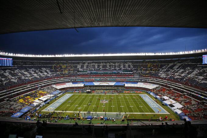 Players for the Los Angeles Chargers and the Kansas City Chiefs warm up before an NFL football game Monday, Nov. 18, 2019, in Mexico City. (AP Photo/Eduardo Verdugo)