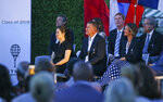 Tennis Hall of Fame inductees, from left, Li Na, of China, Yevgeny Kafelnikov, of Russia, and Mary Pierce, of France, listen during ceremonies at the International Tennis Hall of Fame, Saturday, July 20, 2019, in Newport, R.I. (AP Photo/Stew Milne)