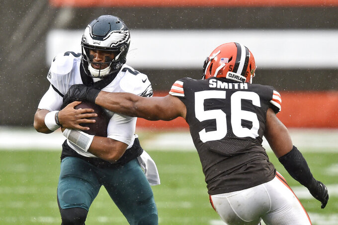Philadelphia Eagles quarterback Jalen Hurts (2) rushes against Cleveland Browns outside linebacker Malcolm Smith (56) during the first half of an NFL football game, Sunday, Nov. 22, 2020, in Cleveland. (AP Photo/David Richard)