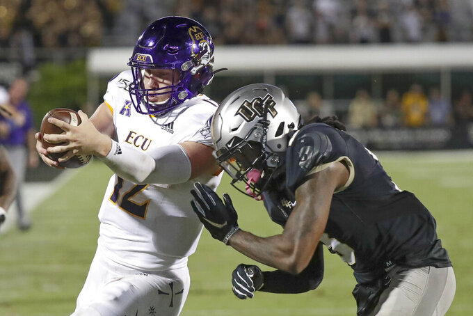 East Carolina quarterback Holton Ahlers, left, scores a touchdown on a 20-yard run as he get past Central Florida defensive back Antwan Collier during the second half of an NCAA college football game, Saturday, Oct. 19, 2019, in Orlando, Fla. (AP Photo/John Raoux)