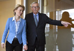 European Commission President Jean-Claude Juncker, right, greets incoming European Commission President Ursula von der Leyen prior to a lunch meeting at EU headquarters in Brussels, Monday, Sept. 9, 2019. (AP Photo/Virginia Mayo)
