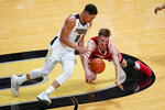 Wisconsin forward Tyler Wahl (5) dives for the ball in front of Purdue forward Mason Gillis (0) during the first half of an NCAA college basketball game in West Lafayette, Ind., Tuesday, March 2, 2021. (AP Photo/Michael Conroy)