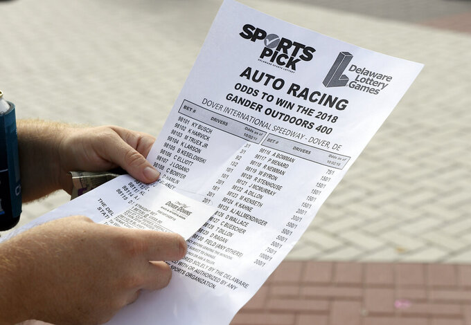 FILE - In this Oct. 7, 2018, file photo, an odds sheet and betting slip are seen at Dover International Speedway before the NASCAR Cup series auto race at Dover International Speedway in Dover, Del. NASCAR is making its first big play in the world of expanded legal sports betting, hoping a sports data partnership will lead to gamblers being able to bet during races on much more than just who gets the checkered flag. Genius Sports has become the exclusive provider of NASCAR data to licensed sportsbooks, officials announced Friday, May 3, 2019. (AP Photo/Nick Wass, File)