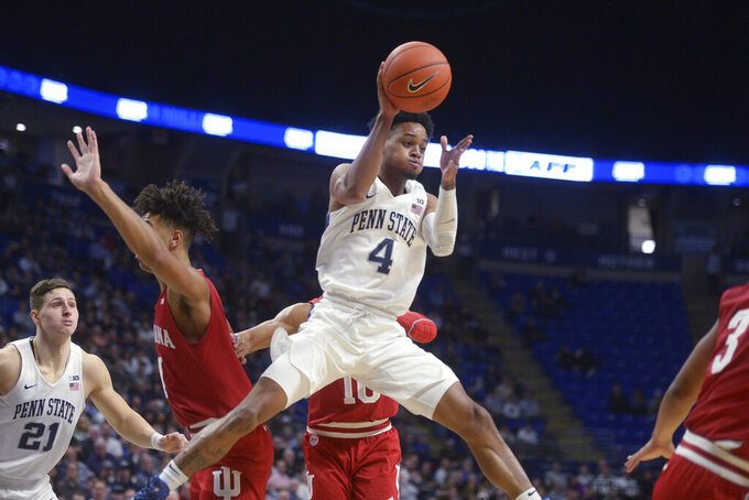 Penn State's Curtis Jones Jr. (4) dishes off a pass in the key against Indiana during the first half of an NCAA college basketball game Wednesday, Jan. 29, 2020, in State College, Pa. (AP Photo/Gary M. Baranec)