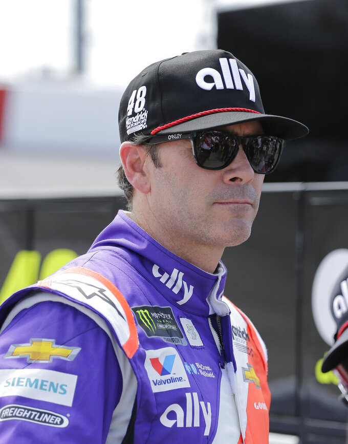 Jimmie Johnson watches during qualifying for the NASCAR Cup series auto race on Saturday, Aug. 31, 2019, at Darlington Raceway in Darlington, S.C. (AP Photo/Terry Renna)