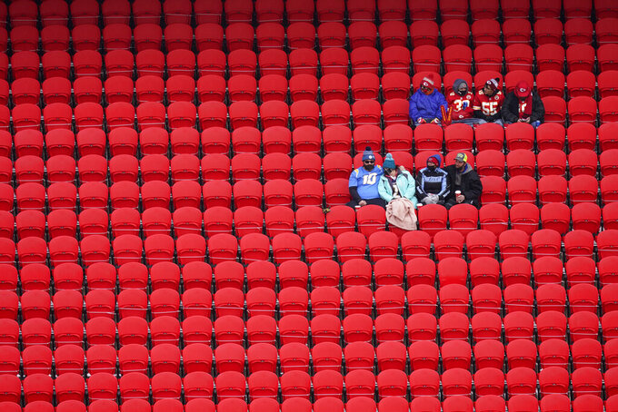 Fans sit in the stands before an NFL football game between the Kansas City Chiefs and the Los Angeles Chargers, Sunday, Jan. 3, 2021, in Kansas City. (AP Photo/Charlie Riedel)