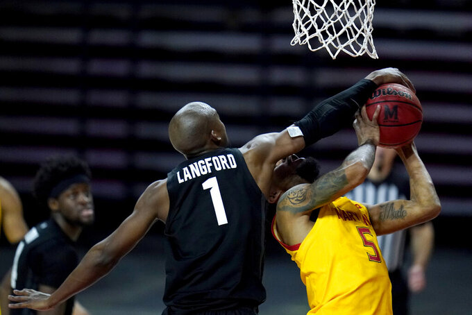 Maryland guard Eric Ayala, right, is fouled by Michigan State guard Joshua Langford during the second half of an NCAA college basketball game, Sunday, Feb. 28, 2021, in College Park, Md. Maryland won 73-55. (AP Photo/Julio Cortez)