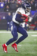 Tennessee Titans running back Derrick Henry (22) finds a hole in the defensive line of the New England Patriots in an NFL wild-card playoff game, Saturday, Jan. 4, 2020 in Foxborough, Mass. The Titans defeated the Patriots 20-13. (Margaret Bowles via AP)