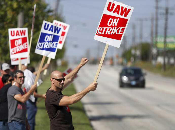 Carl Cvetkovich, front, joins dozens of fellow striking UAW workers outside the GM Parma facility in Parma, Ohio, Monday, Sept. 16, 2019. (Marvin Fong/The Plain Dealer via AP)