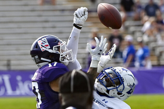 Northwestern wide receiver Bryce Kirtz (17) has a pass broken up by Indiana State defensive back Johnathan Edwards (20) during the first half of an NCAA college football game in Evanston, Ill, Saturday, Sept. 11, 2021. (AP Photo/Matt Marton)