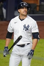 New York Yankees' Giancarlo Stanton reacts after striking out during the fourth inning of the team's baseball game against the Tampa Bay Rays on Friday, April 16, 2021, in New York. (AP Photo/Frank Franklin II)