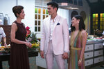 This image released by Warner Bros. Pictures shows, from left, Michelle Yeoh, Henry Golding and Constance Wu in a scene from