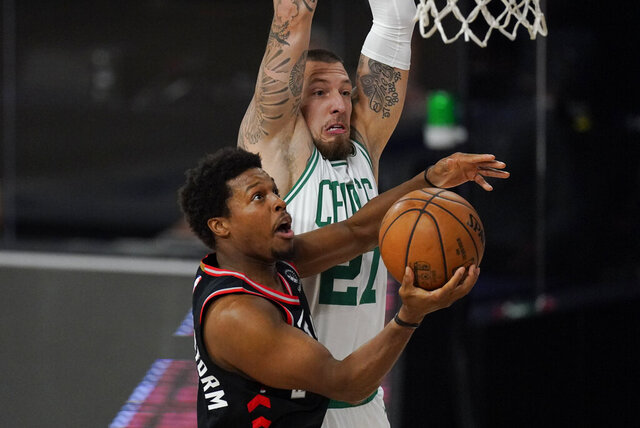 Toronto Raptors' Kyle Lowry drives to the basket ahead of Boston Celtics' Daniel Theis (27) during the first half of an NBA conference semifinal playoff basketball game Saturday, Sept. 5, 2020, in Lake Buena Vista, Fla. (AP Photo/Mark J. Terrill)