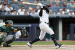 New York Yankees Didi Gregorius hits a two-run single in the eighth-inning of a baseball game against the Oakland Athletics, Sunday, Sept. 1, 2019, in New York. Oakland Athletics catcher Josh Phegley is behind the plate. (AP Photo/Kathy Willens)