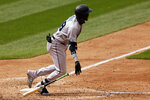 Miami Marlins' Lewin Diaz hits an RBI single during the sixth inning of a baseball game against the New York Mets on Monday, Aug. 31, 2020, in New York. (AP Photo/Adam Hunger)