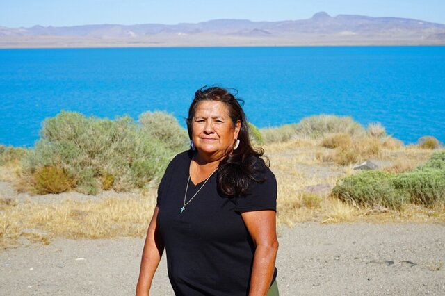 Janet Davis, an enrolled member of the Pyramid Lake Paiute Tribe, stands alongside Pyramid Lake between Nixon, Nev. and Sutcliffe, Nev. on Tuesday, Sept. 8, 2020. As a tribal council member, Davis hopes the coronavirus pandemic doesn't reverse recent progress to expand access to voting on rural reservations like the Pyramid Lake Paiute's and supports lifting limits on ballot assistance to allow tribal members to collect and return ballots on behalf of their neighbors. (AP Photo/Sam Metz)