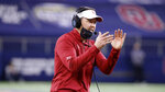 Oklahoma head coach Lincoln Riley directs his team during the Cotton Bowl NCAA college football game in Arlington, Texas, Wednesday, Dec. 30, 2020. Before Oklahoma eventually jumps to the Southeastern Conference, the Sooners first will focus on trying to win their seventh-straight Big 12 title. Oklahoma and Texas have accepted invitations to join the SEC in 2025, adding two marquee names to the already dominant conference. Oklahoma coach Lincoln Riley wants to live in the moment. (AP Photo/Michael Ainsworth)