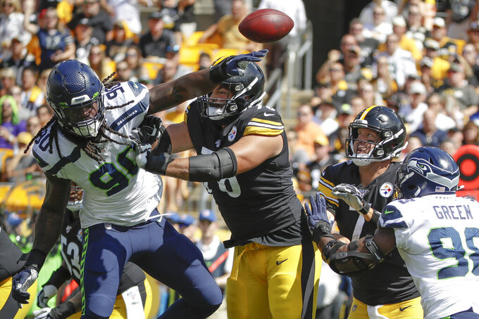 Seattle Seahawks outside linebacker Jadeveon Clowney (90) deflects a pass by Pittsburgh Steelers quarterback Ben Roethlisberger (7) as he is blocked by offensive tackle Alejandro Villanueva (78) in the first half of an NFL football game, Sunday, Sept. 15, 2019, in Pittsburgh. (AP Photo/Gene J. Puskar)
