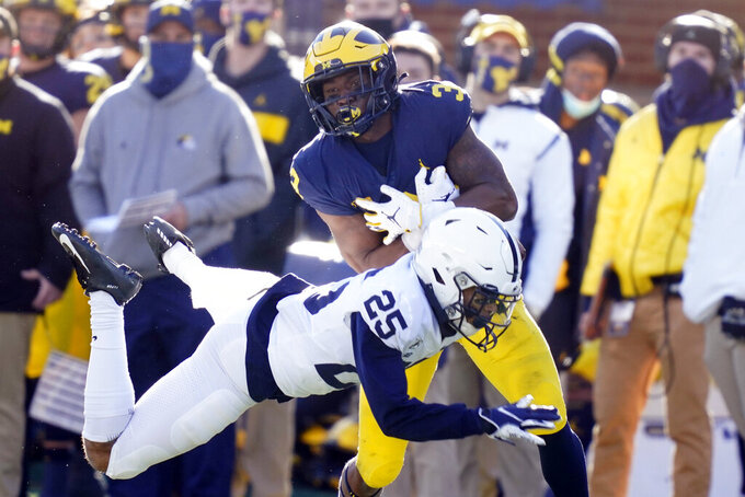 Michigan wide receiver A.J. Henning (3), defended by Penn State cornerback Daequan Hardy (25), makes a catch during the second half of an NCAA college football game, Saturday, Nov. 28, 2020, in Ann Arbor, Mich. (AP Photo/Carlos Osorio)
