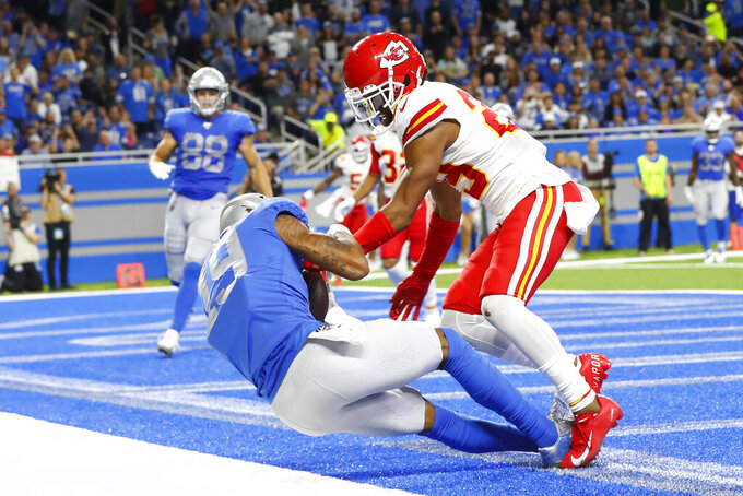 Detroit Lions wide receiver Kenny Golladay, left, defended by Kansas City Chiefs cornerback Kendall Fuller falls into the end zone during the second half of an NFL football game, Sunday, Sept. 29, 2019, in Detroit. The touchdown was overturned. (AP Photo/Paul Sancya)