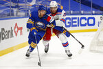 Buffalo Sabres forward Taylor Hall (4) and New York Rangers defenseman Pavel Buchnevich (89) battle behind the net during the second period of an NHL hockey game, Tuesday, Jan. 26, 2021, in Buffalo, N.Y. (AP Photo/Jeffrey T. Barnes)