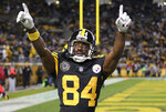 FILE - In this Nov. 16, 2017, file photo, Pittsburgh Steelers wide receiver Antonio Brown celebrates a touchdown catch during the second half of an NFL football game against the Tennessee Titans in Pittsburgh. There was a time, believe it or not, when Brown wasn't an all-world talent with a penchant for self-destruction, but a sixth-round pick hoping to carve a niche in the NFL. (AP Photo/Keith Srakocic, File)