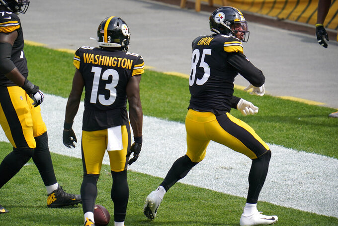 Pittsburgh Steelers tight end Eric Ebron (85) celebrates his touchdown catch during the first half of an NFL football game against the Houston Texans in Pittsburgh, Sunday, Sept. 27, 2020. (AP Photo/Gene J. Puskar)