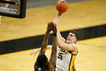 Iowa center Luka Garza (55) shoots over Penn State forward Abdou Tsimbila during the second half of an NCAA college basketball game, Sunday, Feb. 21, 2021, in Iowa City, Iowa. Iowa won 74-68. (AP Photo/Charlie Neibergall)