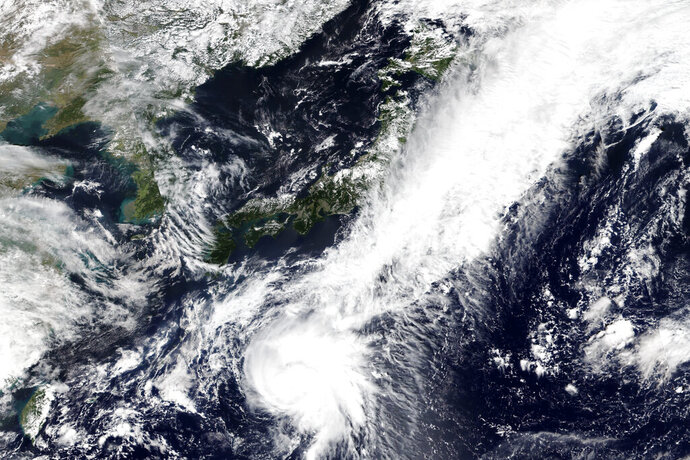 This Tuesday, Sept. 22, 2020, satellite image released by NASA Worldview, Earth Observing System Data and Information System (EOSDIS) shows Tropical Storm Dolphin moving northbound toward Japan's Pacific coast. Japan's Meteorological Agency reports that the storm could reach Japan later his week. (NASA via AP)