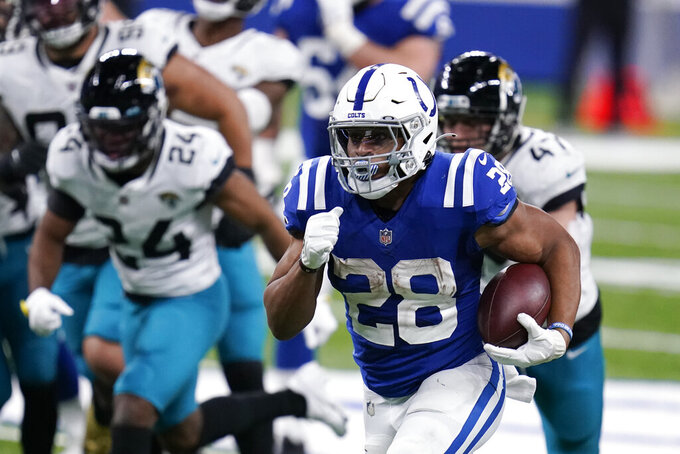 Indianapolis Colts' Jonathan Taylor (28) runs for a touchdown during the second half of an NFL football game against the Jacksonville Jaguars, Sunday, Jan. 3, 2021, in Indianapolis. (AP Photo/Michael Conroy)