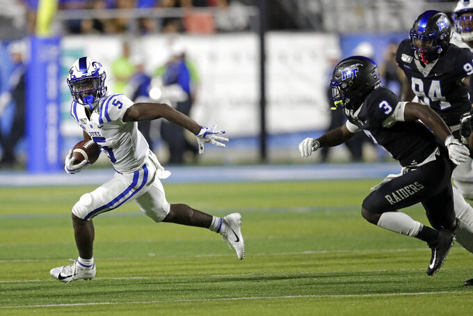 Duke wide receiver Jalon Calhoun (5) tries to get past Middle Tennessee safety Gregory Grate Jr. (3) in the first half of an NCAA college football game Saturday, Sept. 14, 2019, in Murfreesboro, Tenn. (AP Photo/Mark Humphrey)
