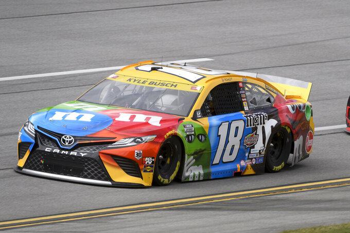 Kyle Busch races in a NASCAR Cup series auto race Monday, Oct. 4, 2021, in Talladega, Ala. (AP Photo/John Amis)