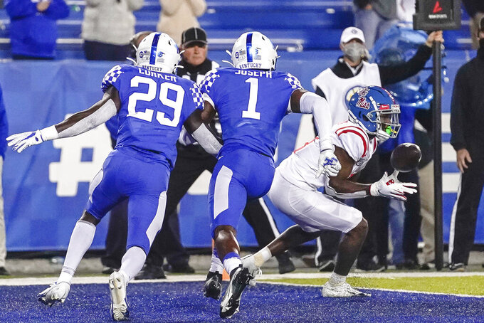 Mississippi wide receiver Elijah Moore (8) catches the winning touchdown pass during overtime of an NCAA college football game, Saturday, Oct. 3, 2020, in Lexington, Ky. (AP Photo/Bryan Woolston)