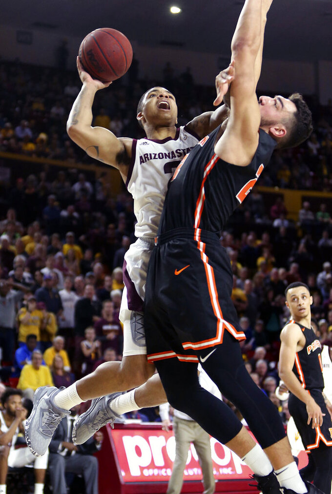 Arizona State guard Rob Edwards, left, drives to the basket as Princeton's Jerome Desrosiers defends during the second half of an NCAA college basketball game, Saturday, Dec. 29, 2018, in Tempe, Ariz. (AP Photo/Ralph Freso)