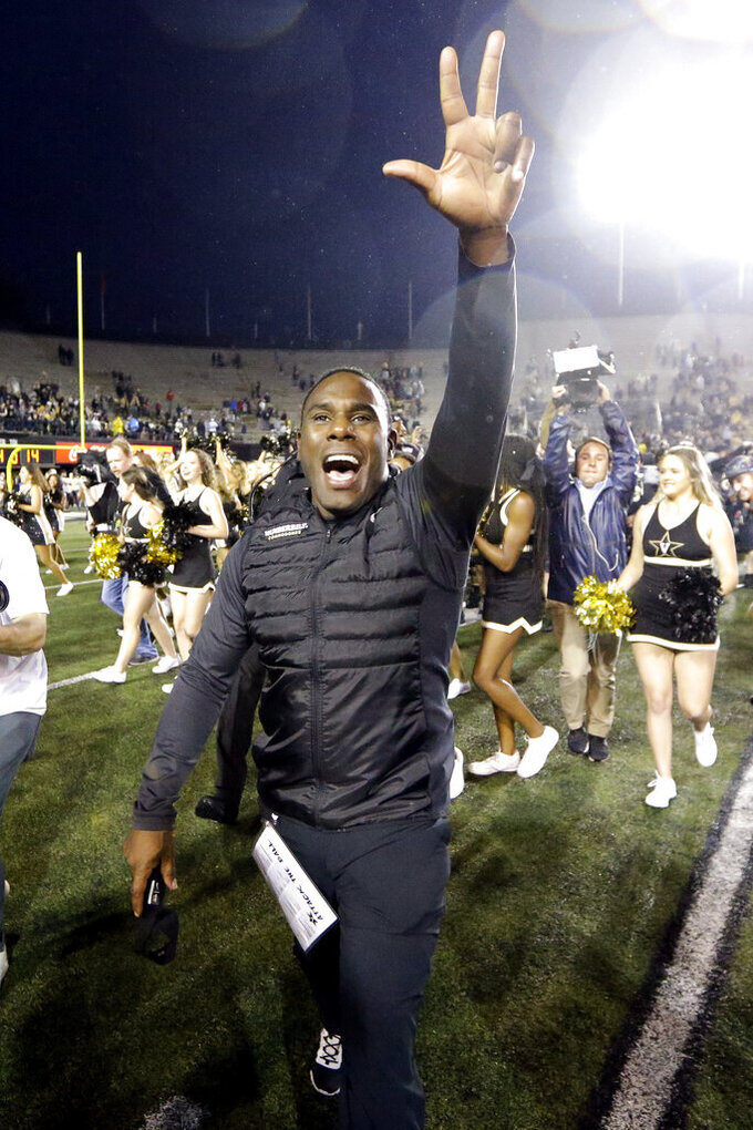 Vanderbilt head coach Derek Mason celebrates after Vanderbilt upset Missouri in an NCAA college football game Saturday, Oct. 19, 2019, in Nashville, Tenn. Vanderbilt won 21-14. (AP Photo/Mark Humphrey)