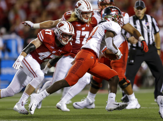 Western Kentucky running back Garland LaFrance runs next to Wisconsin linebacker Griffin Grady (47) during the first half of an NCAA college football game Friday, Aug. 31, 2018, in Madison, Wis. (AP Photo/Andy Manis)