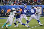 New York Giants quarterback Eli Manning (10) passes against the Miami Dolphins during the second quarter of an NFL football game, Sunday, Dec. 15, 2019, in East Rutherford, N.J. (AP Photo/Seth Wenig)
