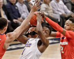 Clemson's Javan White, left, and Marcquise Reed, right, block a shot by Pittsburgh's Xavier Johnson (1) during the first half of an NCAA college basketball game, Wednesday, Feb. 27, 2019, in Pittsburgh. (AP Photo/Keith Srakocic)