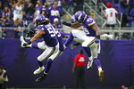 Minnesota Vikings defensive end Danielle Hunter, right, and Eric Kendricks (54) celebrate with teammates during the first half of an NFL football game against the Atlanta Falcons, Sunday, Sept. 8, 2019, in Minneapolis. (AP Photo/Bruce Kluckhohn)