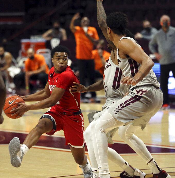 Radford's Fah'Mir Ali (0) looks to pass during the the second half of an NCAA college basketball game against Virginia Tech, Wednesday Nov. 25, 2020, in Blacksburg Va. (Matt Gentry/The Roanoke Times via AP)